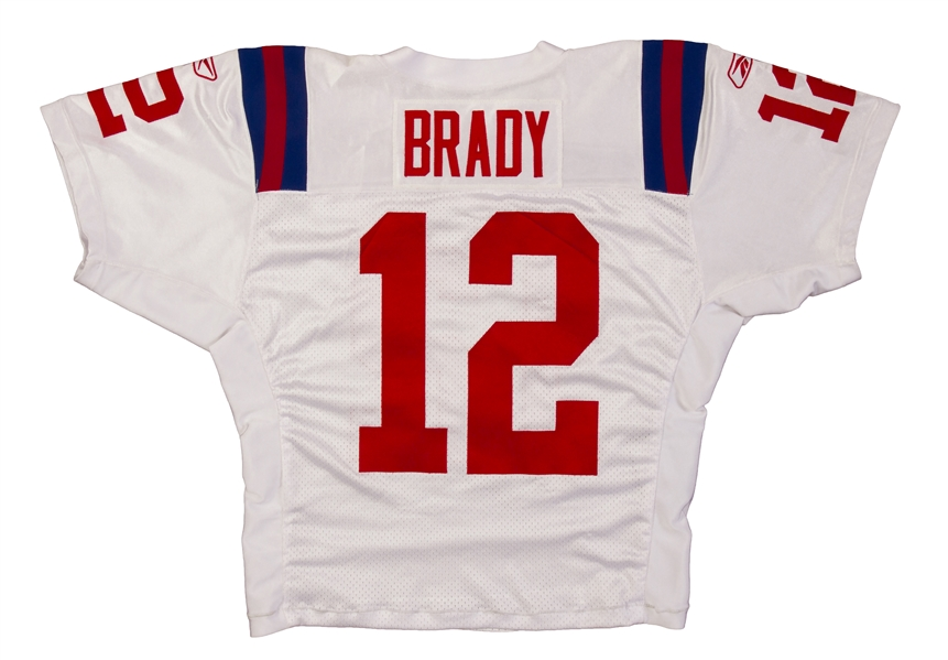 Reebok logos are embroidered above Brady s number 12 on both sleeves. This  historic jersey comes with corresponding NFL PSA DNA COA  58935. 19504ddce