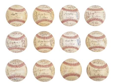 Lot of (12) 1986 Los Angeles Angels Team Signed OAL Brown Baseballs With Reggie Jackson (Autry LOA & Beckett PreCertt)